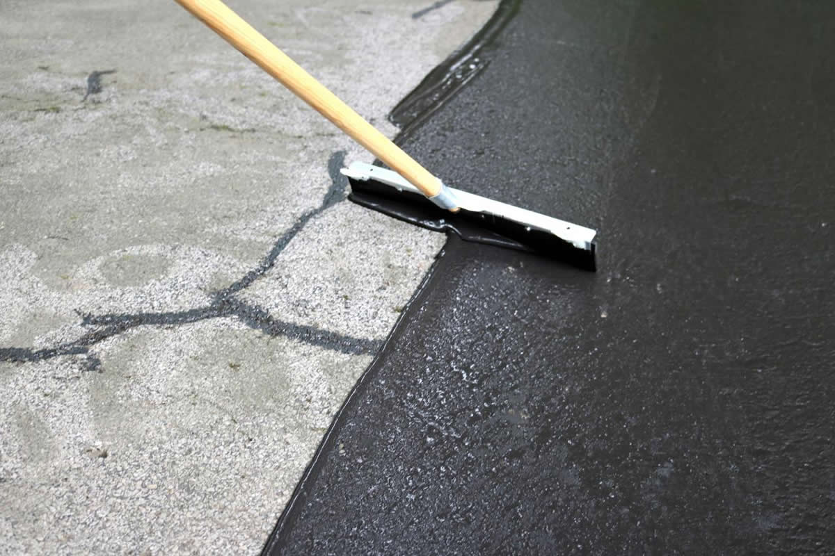 How to Know When to Resurface or Repair Your Asphalt Driveway